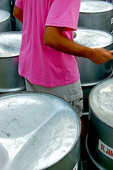 Young man playing steel drums